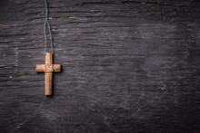 Brown Cross On A Black Wooden ...