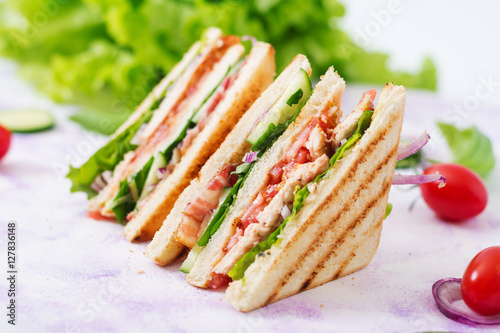 Fotobehang Snack Club sandwich with chicken breast, bacon, tomato, cucumber and herbs