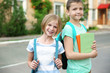 Cute schoolkids on street
