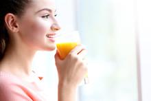 Young Beautiful  Woman Drinking Juice