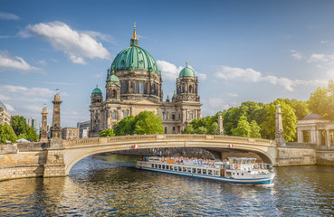 Fototapeta Berlin Cathedral with ship on Spree river at sunset, Berlin Mitte, Germany