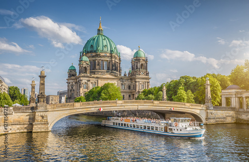 Berlin Cathedral with ship on Spree river at sunset, Berlin Mitte, Germany