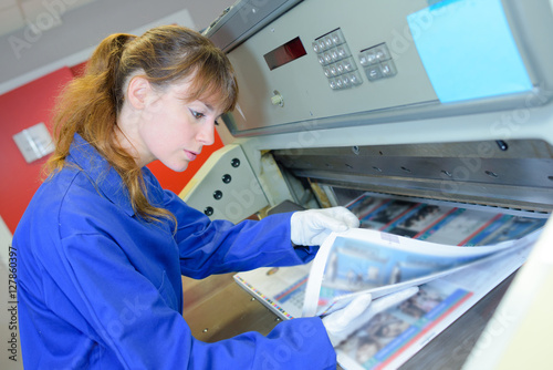 adf3b8c646 Woman examining printed material - Buy this stock photo and explore ...