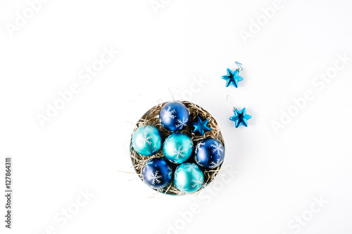 round box with bright blue christmas balls on white background flat lay top view - Blue Christmas Balls