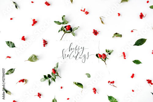 Words Happy Holidays And Minimal Creative Berry Arrangement Pattern On White Flat Lay Top