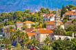 Splitska village stone landmarks in palm trees