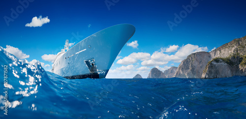 Luxury Yacht on the sea taken from water with mountains in background. Amazing beautiful view.