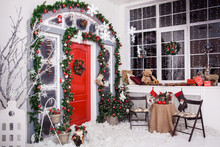 Winter Decoration. Red Dor With Christmas Wreath And Tree Branches
