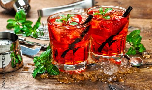 Fotografie, Obraz  Red drink ice. Juice. Aperitif. Cocktail making bar tools