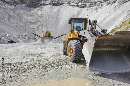 Quarry aggregate with heavy duty machinery. Construction industr Wallpaper Mural