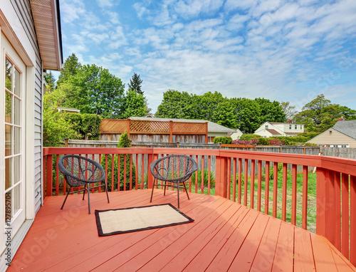 Fototapeta Backyard of craftsman home with red deck obraz na płótnie