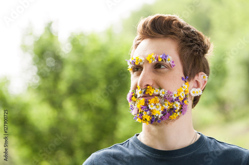 Fotografie, Obraz portrait of a guy with flowers instead of his beard