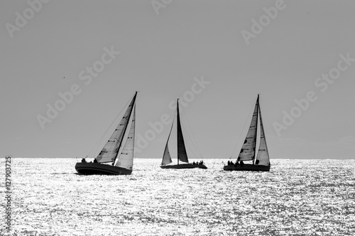boat race on sea sunset in black and white Wallpaper Mural
