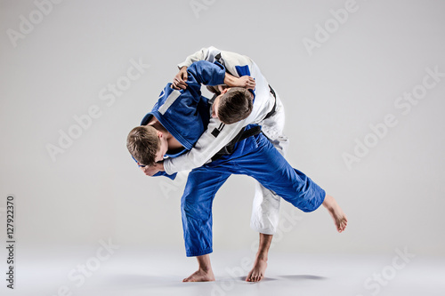 The two judokas fighters fighting men Poster