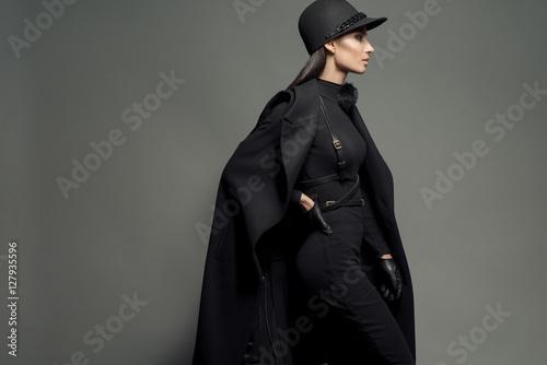 Elegance dressed fashionable model in jockey cap