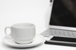 Coffee cup on white desk and laptop for background,drink between