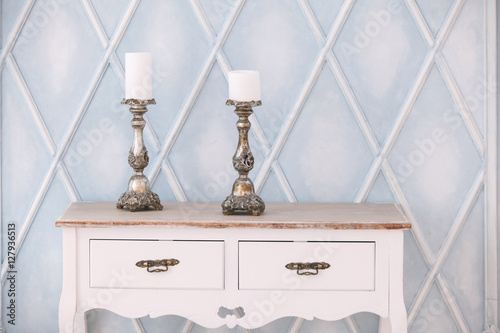 Fényképezés  white dresser in the light room and candlesticks from silver