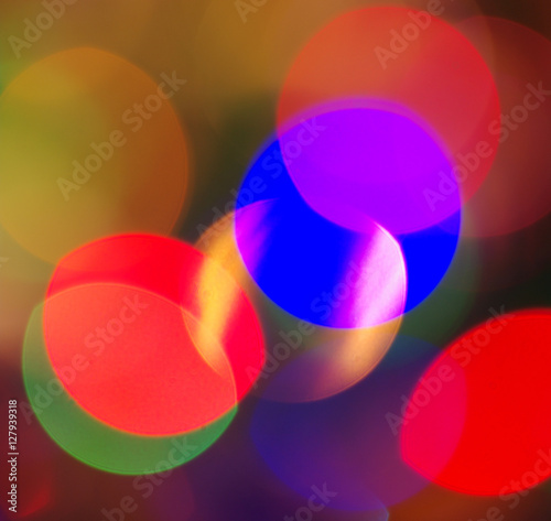 Colourful festive multi-colored circles . Defocused abstract multicolored bokeh lights background