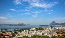 Aerial View Of Guanabara Bay, Sugarloaf Mountain, Residental Buildings And Santa Amaro Slum (favela) Of Rio De Janeiro, Brazil