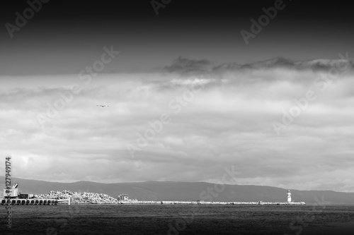 Photo  Black and white lighthouse pier background