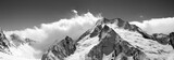 Black and white mountain panorama in clouds - 127957516