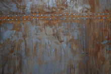 Rusty Metal With Rivets