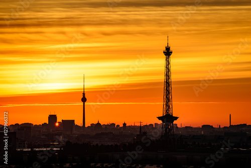 Berlin Sykline and orange sky in the morning at sunrise Wallpaper Mural
