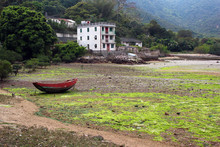 Low Tide In Abandoned Village Of Chek Keng, Hong Kong. Fishing Boat On The Ground
