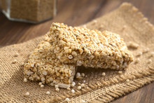 Granola Or Cereal Bars Made Of Popped Quinoa, Sesame Seed, Popped Rice, Sunflower Seed, Chia And Honey, Photographed With Natural Light (Selective Focus, Focus On The Front Edge Of The Upper Bar)