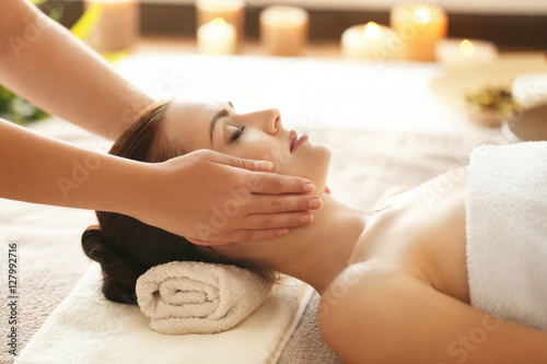 Poster Spa Spa concept. Young woman enjoying of facial massage in spa salon