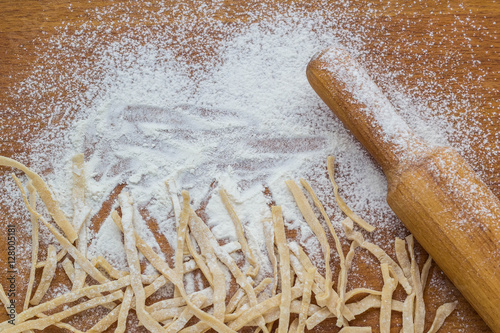 Fotografie, Obraz  making homemade noodles. Flour and rolling pin