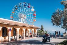 Multicolour Ferris Wheel And Small Square Around