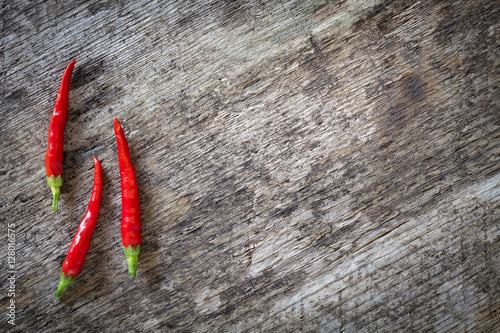 Photo  Red chilli peppers on aged wood
