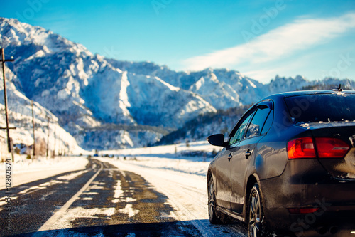 The brown car in the mountains the road.Extreme Winter Road Cond Slika na platnu