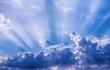 Leinwandbild Motiv Sunbeams through the clouds