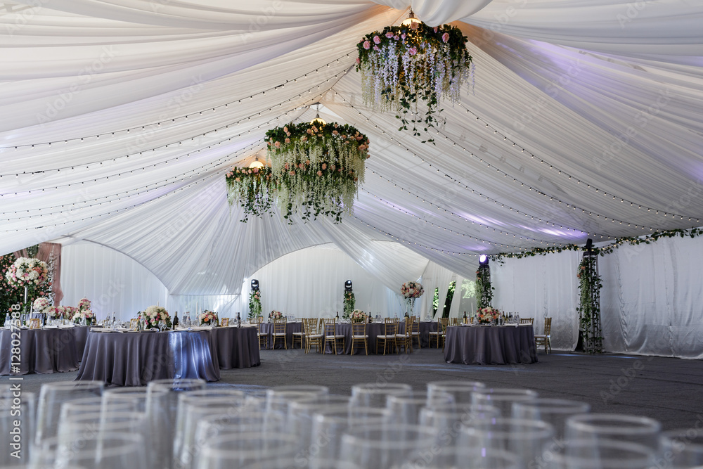 Fototapety, obrazy: Look over empty glassware at white tent prepared for wedding din