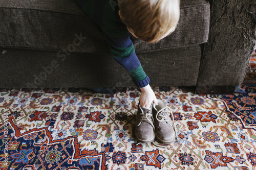 Excellent The Hands Of A Boy On A Dark Brown Couch And A Pair Of Alphanode Cool Chair Designs And Ideas Alphanodeonline