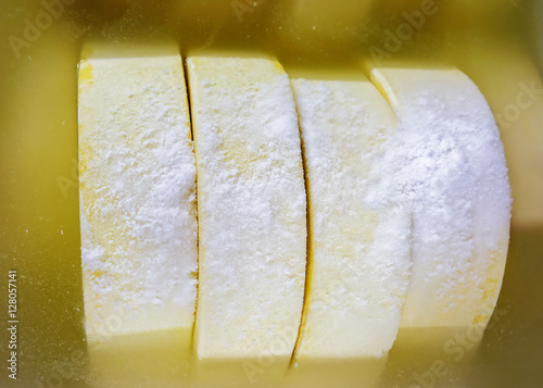 Young Comte Cheese in bath with salt Burgundy