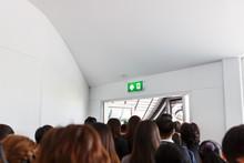 People Escape To Fire Exit Door