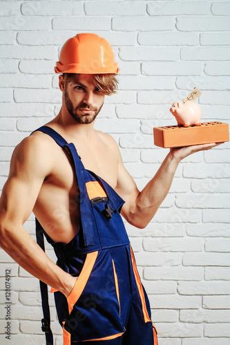 Valokuva  sexy muscular man builder with moneybox