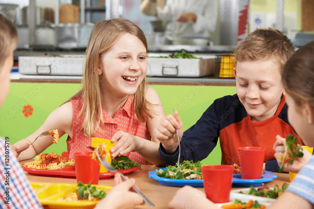Peachy Foto Group Of Pupils Sitting At Table In School Cafeteria Eating Lunc Download Free Architecture Designs Embacsunscenecom