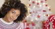 Close up on beautiful single grinning woman near white Christmas tree with copy space