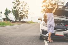 Woman With Hatchback Car Broken Down In Vintage Tone