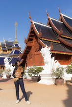 Thai Woman With Pomeranian At Wat Ban Den In Chiangmai Thailand