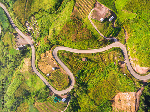 In de dag Luchtfoto Aerial view of crooked path of road on the mountain, Shot from d