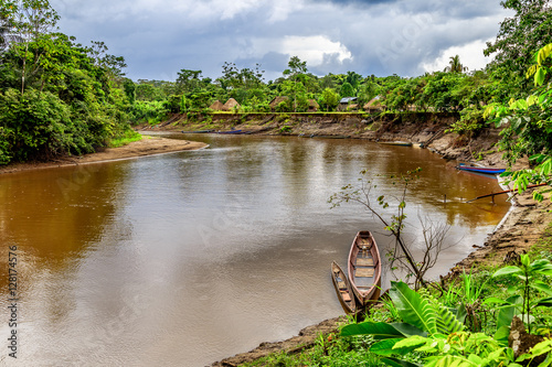Photo River with wooden boat in Amazonia , Cuyabeno , Ecuador