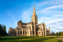 View Of Salisbury Cathedral Church Of The Blessed Virgin Mary At Sunrise From East. The Building Is Superb Example Of Early English Gothic Architecture.Copy Space In Blue Sky.