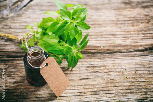 Fresh basil and oil on wooden background Wallpaper Mural