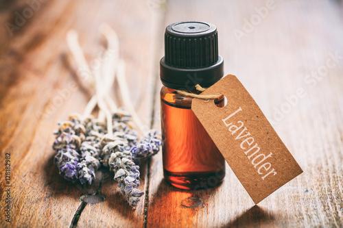 Obraz na plátně Lavender bunch and oil on wooden background