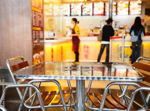 Fototapeta Seats and table at a fast food cafe obraz